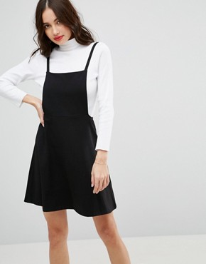 photo Mini Pinafore Dress with Strappy Back by ASOS, color Black - Image 1