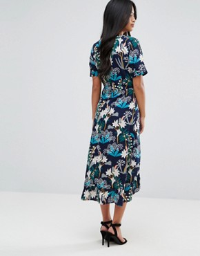 photo Floral Midi Wrap Dress by Yumi Petite, color Black Floral - Image 2