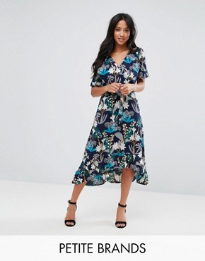 photo Floral Midi Wrap Dress by Yumi Petite, color Black Floral - Image 1