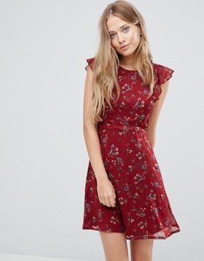 photo Frill Sleeve Dress in Mini Floral Print by Yumi, color Burgundy - Image 1