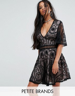 photo Tea Dress in Lace with Ladder Detail by Sisters Of The Tribe Petite, color Black - Image 1
