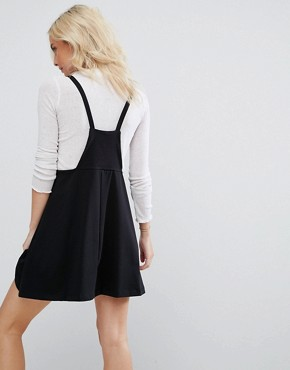 photo Mini Pinafore Dress with strappy back by ASOS PETITE, color Black - Image 2
