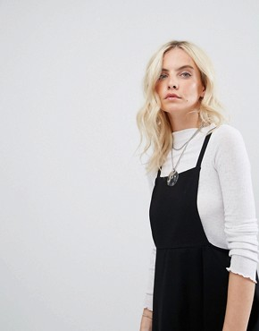 photo Mini Pinafore Dress with strappy back by ASOS PETITE, color Black - Image 3