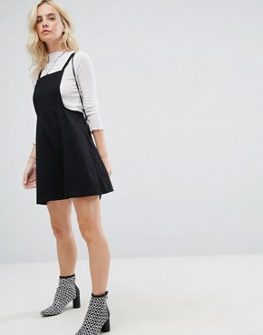 photo Mini Pinafore Dress with strappy back by ASOS PETITE, color Black - Image 4