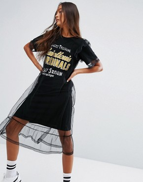 photo Varsity T-Shirt Dress with Backprint and Mesh Overlayer by STYLENANDA, color Black - Image 1
