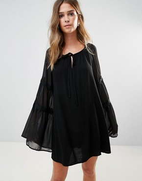photo Bell Sleeve Tunic Dress by Lunik, color Black - Image 1