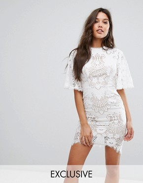 photo Allover Lace Open Back Mini Dress with Fluted Sleeve Detail by Love Triangle, color White - Image 1