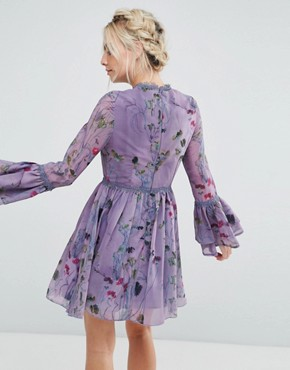 photo All Over Floral Skater Dress with Fluted Sleeve Detail by Little Mistress Petite, color Multi Purple - Image 2