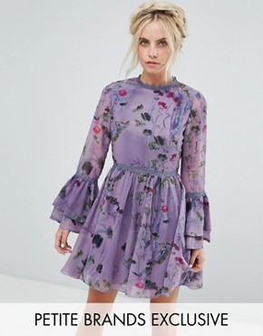 photo All Over Floral Skater Dress with Fluted Sleeve Detail by Little Mistress Petite, color Multi Purple - Image 1