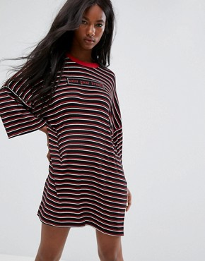 photo Oversized Save Your Breath T-Shirt Dress in Stripe by The Ragged Priest, color Black - Image 1