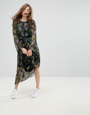 photo Ebony Floral Print Asymmetric Hem Dress by Gestuz, color Black Flower - Image 1