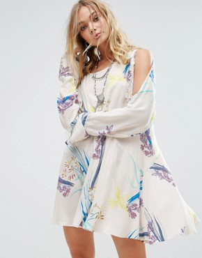 photo Clear Skies Cold Shoulder Printed Dress by Free People, color Neutral - Image 1