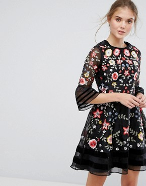 photo Premium Embroidered Mini Dress with Exaggerated Sleeve by Frock and Frill, color Black - Image 1