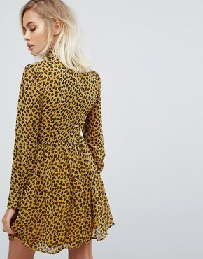 photo High Neck Skater Dress in Leopard Print by Fashion Union, color Yellow Animal - Image 2