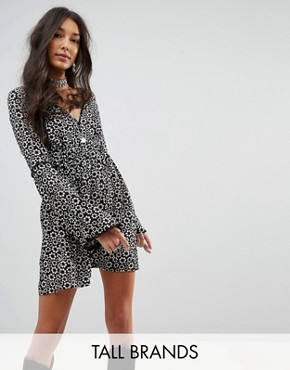 photo Swing Dress with Flared Sleeves and Tie Front in Daisy Chain Print by Kiss The Sky Tall, color Black - Image 1