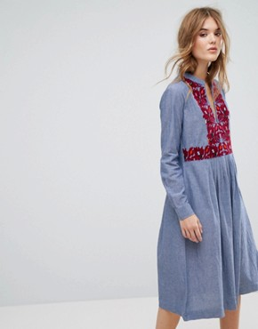 photo Embroidered Midi Dress in Chambray by Leon and Harper, color Blue - Image 1