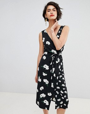 photo Floating Orchid Wrap Front Cami Dress by Warehouse, color Black Print - Image 1