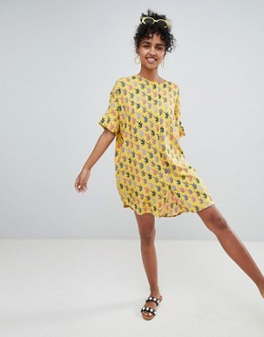 photo Tiger Print Dress in Yellow by Monki, color Yellow - Image 1