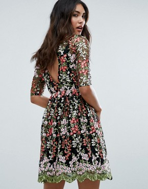 photo Floral Embroided All Over Skater Dress by Club L, color Black - Image 1