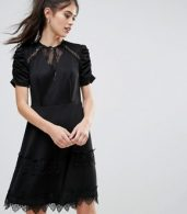 photo Detailed Crochet & Lace Skater Dress with Puff Detailed Sleeves by Club L, color Black - Image 1