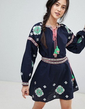 photo Long Sleeve Embroidered Skater Dress by RD & Koko, color Navy - Image 1