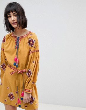 photo Long Sleeve Embrodiered Festival Skater Dress by RD & Koko, color Mustard - Image 1