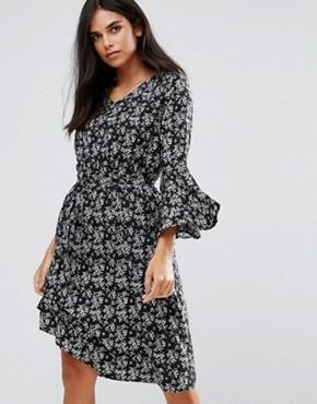 photo Flare Sleeve Dress in Floral Print by Yumi, color Black - Image 1