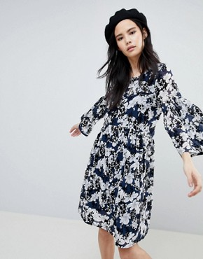 photo Floral Flock Swing Dress by Soaked in Luxury, color Blue - Image 1