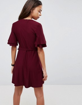 photo Mini Wrap Dress with Double Flutter Sleeve by ASOS PETITE, color Oxblood - Image 2