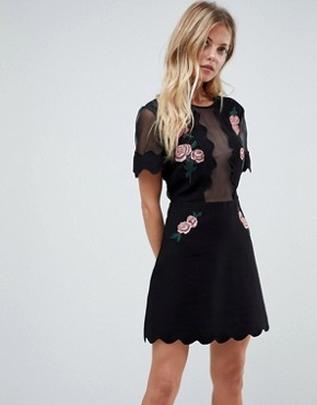 photo Taken Sheer Chest Floral Mini Dress by Isla, color Black With Floral - Image 1