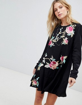 photo Embroidered Mini Drop Waist Dress by ASOS, color Black - Image 1