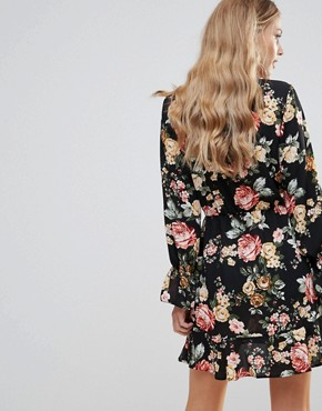 photo Floral Wrap Frill Long Sleeve Dress by Oh My Love, color Red Winter Floral - Image 2