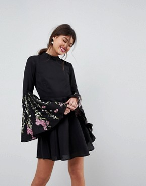 photo Fluted Sleeve Embroidered Skater Mini Dress by ASOS, color Black - Image 1