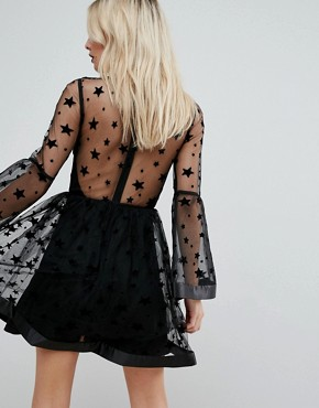 photo Star Mesh Fluted Sleeve Mini Skater Dress by ASOS PETITE, color Black - Image 2