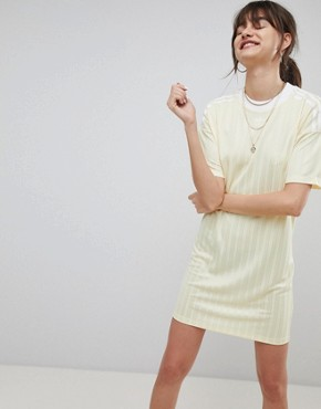 photo Adicolor Three Stripe Dress in Yellow by adidas Originals, color Yellow - Image 1