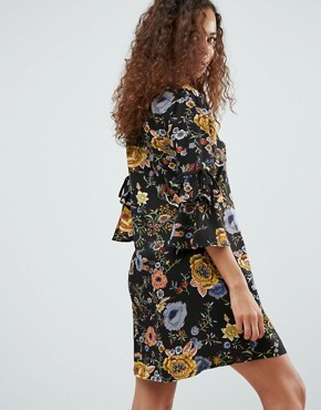 photo Smock Dress with Necktie and Tie Sleeve Detail by Yumi Petite, color Black Floral - Image 2