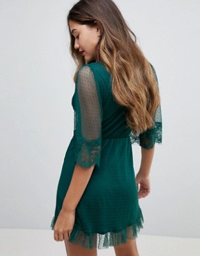 photo Dobby Knot Front Lace Trim Mini Skater Dress by ASOS, color Forest Green - Image 2