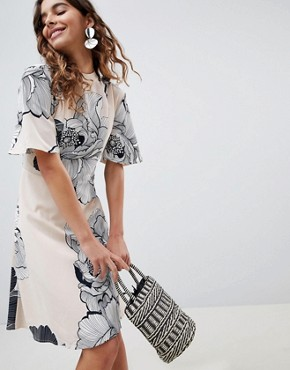 photo Floral High Neck Woven Dress by b.Young, color  - Image 1