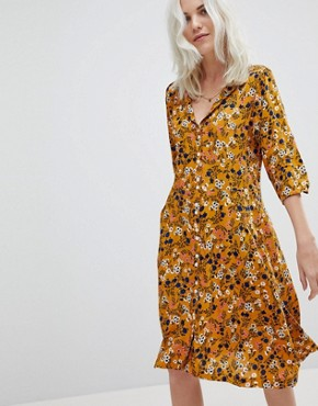 photo Floral Tea Dress by Trollied Dolly, color Mustard - Image 1
