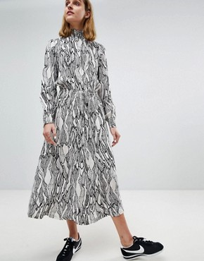 photo High Neck Midi Dress in Abstract Leaf Print by Moss Copenhagen, color White - Image 1