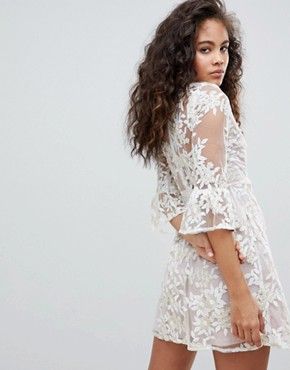 photo Allover Embroidered High Neck Skater Dress with Fluted Hem Detail by Dolly & Delicious Tall, color Cream - Image 2