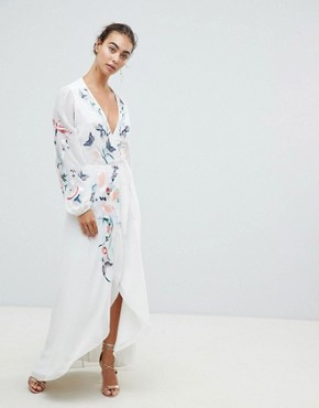 photo Wrap Front High Low Maxi Dress with Floral Embroidery by Hope & Ivy, color White - Image 1