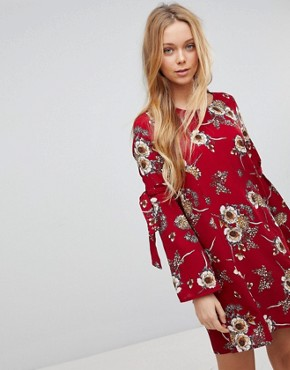 photo Floral Dress with Flare Tie Sleeve by Girls on Film, color Burgundy Base Print - Image 1