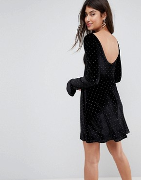 photo Studded Velvet Scoop Back Skater Dress with Frill Cuffs by ASOS, color Black With Gold Studs - Image 1