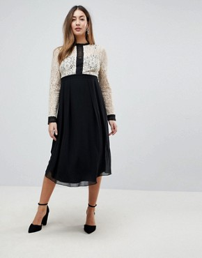 photo All Over Lace Top Dress with Prom Skater Skirt by Little Mistress Maternity, color Cream/Black Multi - Image 1