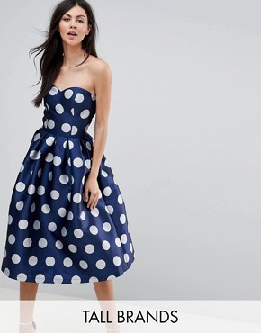 photo Structured Bandeau Midi Dress in Polkadot by Chi Chi London Tall, color Navy Polka - Image 1