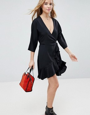 photo Wrap Front Mini Frill Dress by ASOS, color Black - Image 1