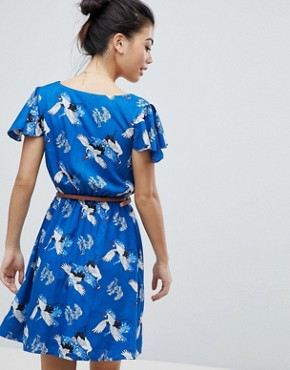photo Wrap Front Dress with Belt in Heron Print by Yumi Petite, color Blue - Image 2