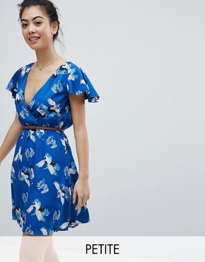 photo Wrap Front Dress with Belt in Heron Print by Yumi Petite, color Blue - Image 1