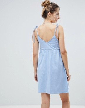 photo Maternity Mini Smock Sundress with Tie Straps by ASOS DESIGN, color Chambray Blue - Image 2